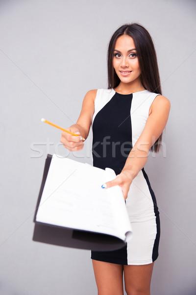 Nő ruha irat aláírás portré fiatal nő Stock fotó © deandrobot