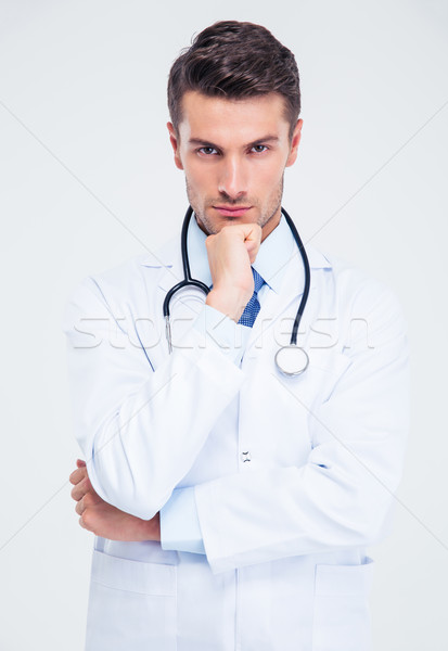 Portrait of a pensive male doctor looking at camera Stock photo © deandrobot