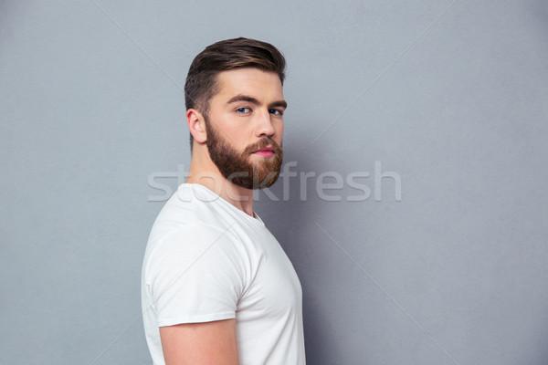 Zijaanzicht portret man naar camera permanente Stockfoto © deandrobot