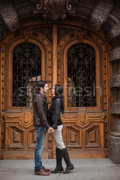 Young couple flirting outdoors Stock photo © deandrobot