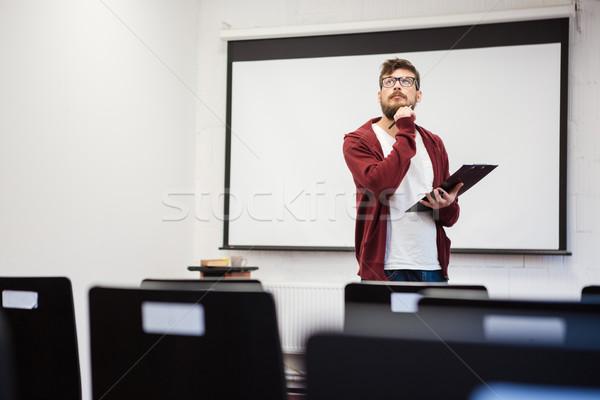 Genç öğretmen ders modern sakal sınıf Stok fotoğraf © deandrobot
