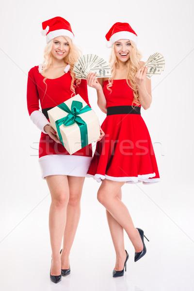 Dwa siostry bliźnięta Święty mikołaj suknie Zdjęcia stock © deandrobot