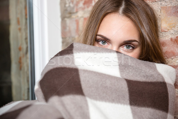 Woman peeking from warm plaid  Stock photo © deandrobot