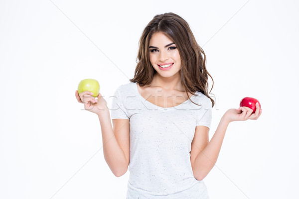 Smiling lovely woman holding two apples Stock photo © deandrobot