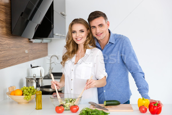 Stock photo: Beautiful couple standing and cooking together