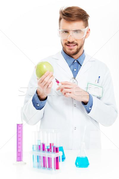 химик инъекций яблоко мужчины изолированный белый Сток-фото © deandrobot