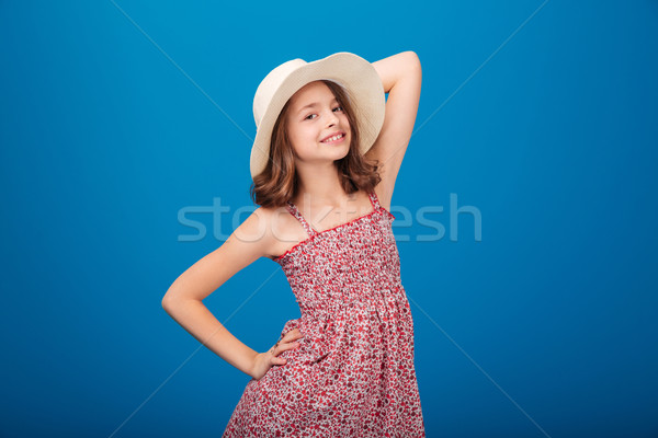 Portrait of beautiful smiling little girl in hat and sundress   Stock photo © deandrobot