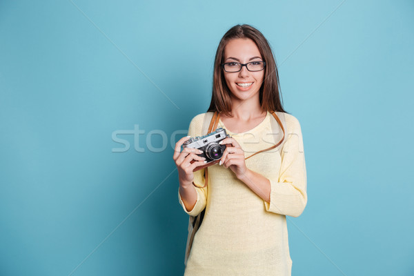 Cheerful young woman with photo camera Stock photo © deandrobot