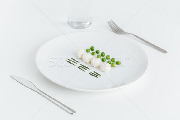 Yeşil bezelye biberiye mozzarella plaka Stok fotoğraf © deandrobot
