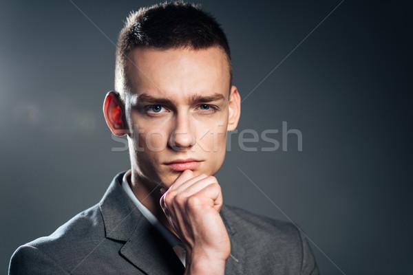 Dalgın işadamı bakıyor kamera gri adam Stok fotoğraf © deandrobot