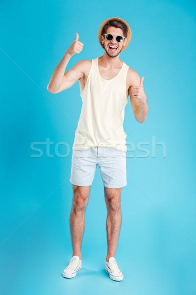 молодым человеком оба рук Сток-фото © deandrobot