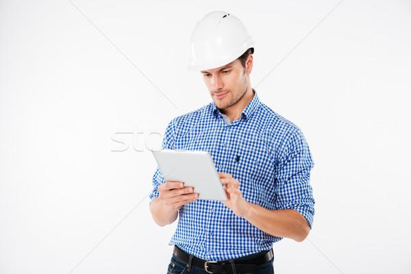 深刻 男 建築 ヘルメット 立って タブレット ストックフォト © deandrobot