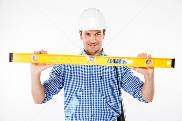 幸せ 若い男 ビルダー 建物 ヘルメット ストックフォト © deandrobot
