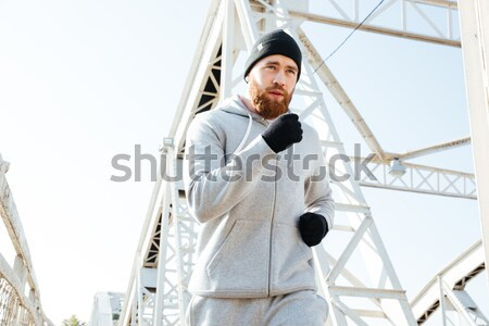 Handsome casual young man showing excitement Stock photo © deandrobot