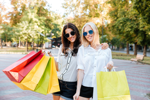 Two beautiful young woman shopping in the city Stock photo © deandrobot