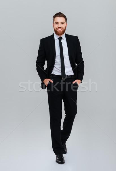 Homem de negócios mãos sorridente barbudo terno preto Foto stock © deandrobot