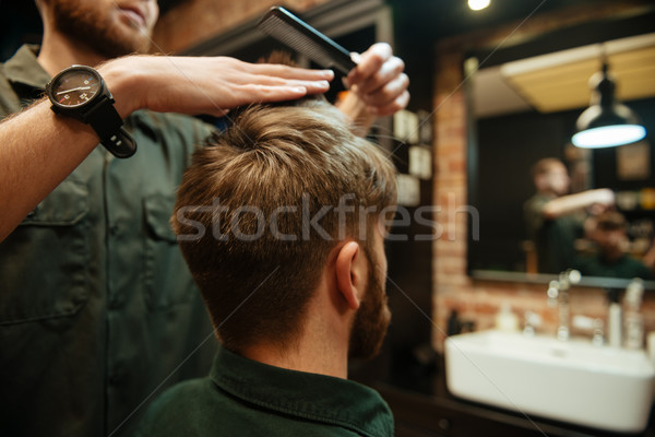Professional stylist cut hair of his client Stock photo © deandrobot