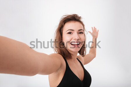 Cheerful young fitness woman make a selfie Stock photo © deandrobot