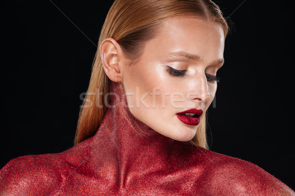 Pretty woman with unusual body art looking down Stock photo © deandrobot