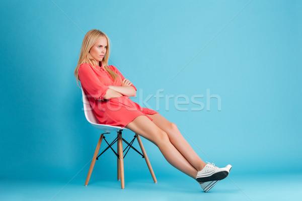 少女 赤いドレス 座って 椅子 ストックフォト © deandrobot