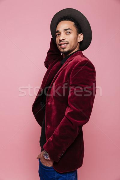 Afro Mann hat Jacke stehen Stock foto © deandrobot