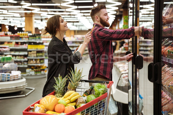 Heureux affectueux couple supermarché image Photo stock © deandrobot