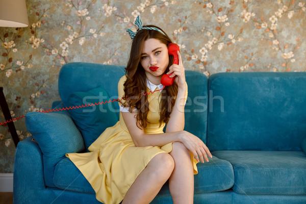 Unatkozik fiatal pinup hölgy beszél telefon Stock fotó © deandrobot