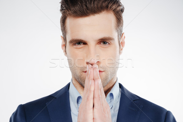 Close-up portrait of Man in suit showing pray gesture Stock photo © deandrobot