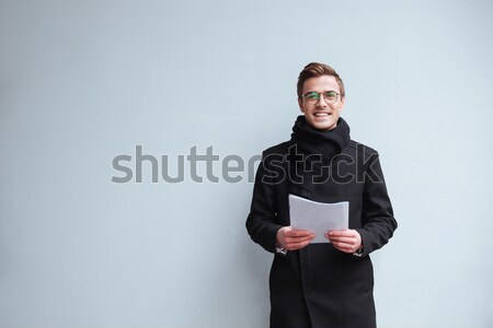Pregnant business woman using mobile phone. Looking aside. Stock photo © deandrobot