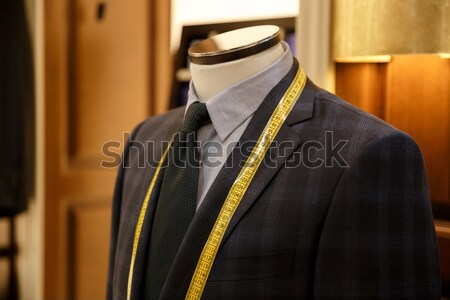 Photo of men suit jackets on hanger Stock photo © deandrobot