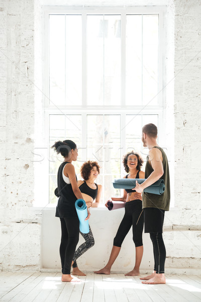 Full-length shot of positive people talking in gym Stock photo © deandrobot
