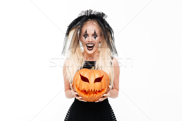 Crazy smiling woman dressed in black widow costume Stock photo © deandrobot