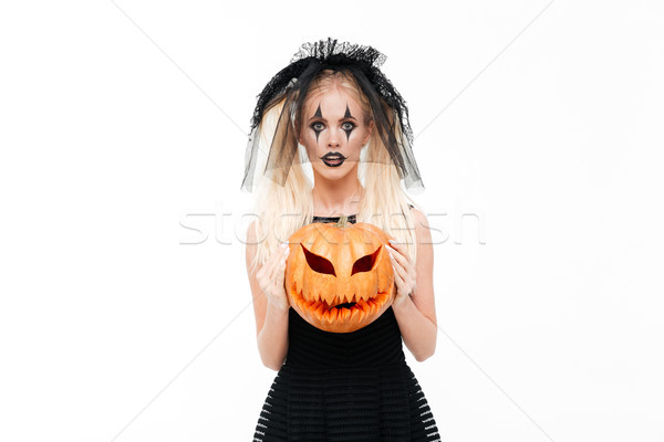 Frightful blonde woman dressed in black widow Stock photo © deandrobot