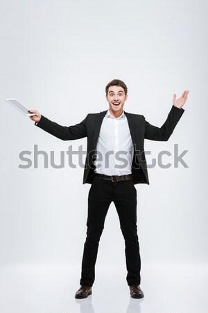 Schreeuwen jonge man winnaar gebaar Stockfoto © deandrobot