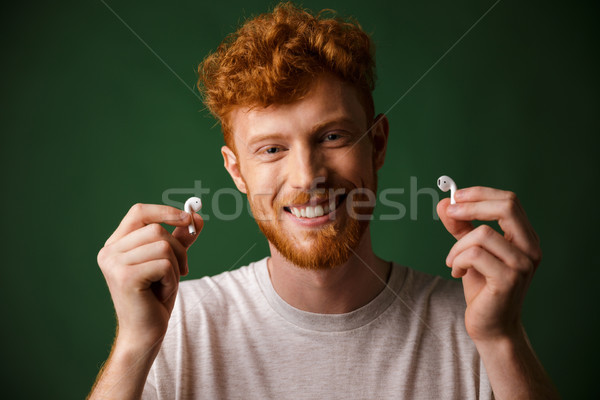 Close-up of young smiling curly redhead bearded young man in whi Stock photo © deandrobot