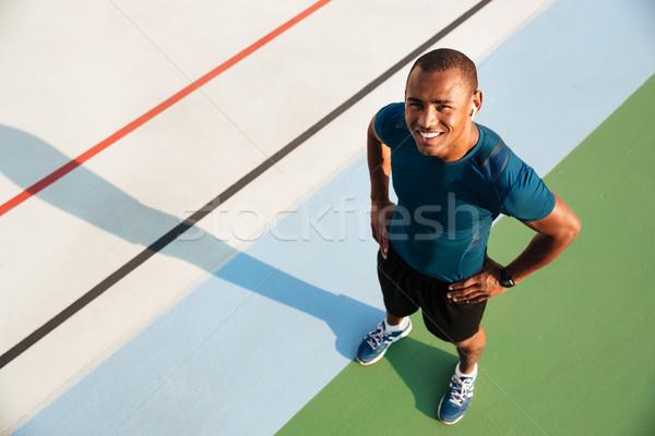 Haut vue portrait souriant musculaire afro Photo stock © deandrobot