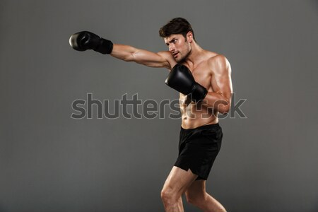 Side view portrait of a focused muscular adult sportswoman Stock photo © deandrobot