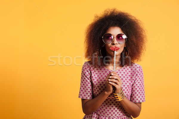 Portrait of a funny afro american woman Stock photo © deandrobot