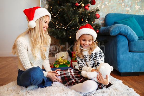 Genç mutlu anne kız oyuncak ayı Stok fotoğraf © deandrobot
