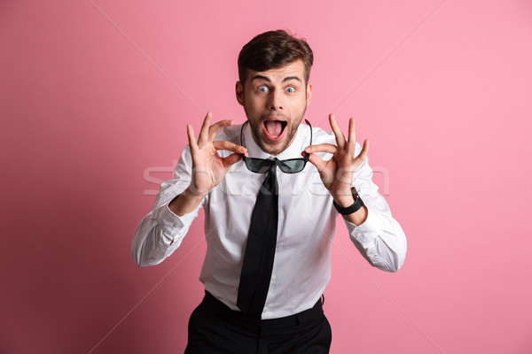 Retrato feliz conmocionado hombre blanco camisa Foto stock © deandrobot