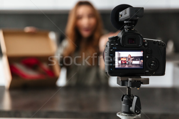 Smiling young girl recording her video blog episode Stock photo © deandrobot