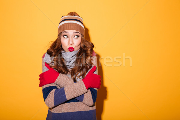 Portrait of a pretty frozen girl dressed in winter clothes Stock photo © deandrobot