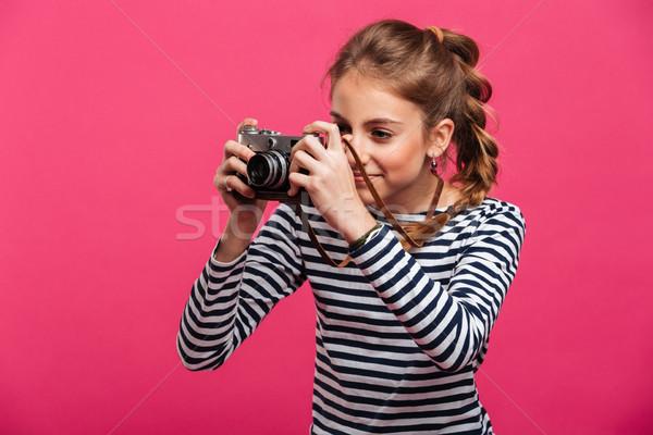Teenage girl photographer Stock photo © deandrobot