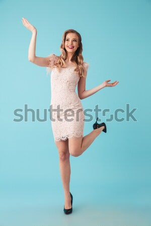 Full length portrait of a cheerful girl dressed in dress Stock photo © deandrobot
