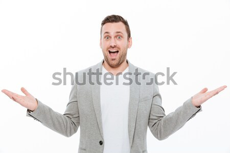 Portrait of caucasian man with stubble throwing up arms on camer Stock photo © deandrobot