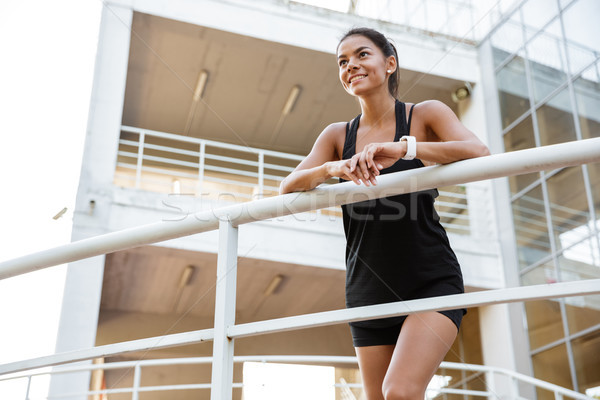 Retrato bastante mujer de la aptitud rail Foto stock © deandrobot