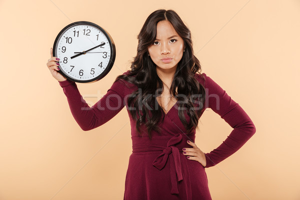 Adult lady with curly long hair holding clock with time after 8  Stock photo © deandrobot