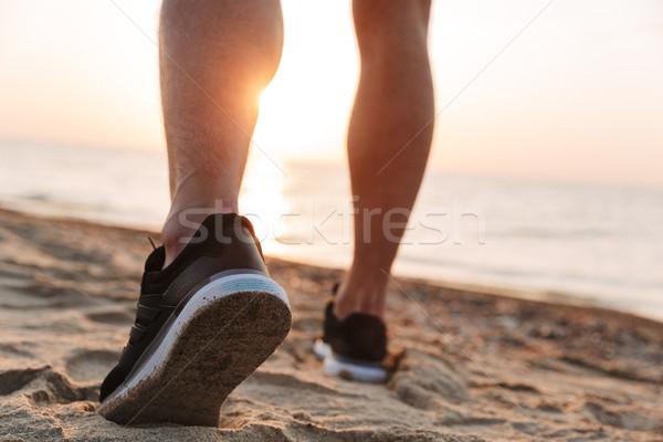 Back view of a sportsmen's legs running Stock photo © deandrobot