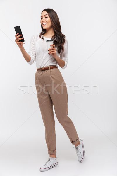 Stok fotoğraf: Tam · uzunlukta · portre · gülen · Asya · işkadını · cep · telefonu