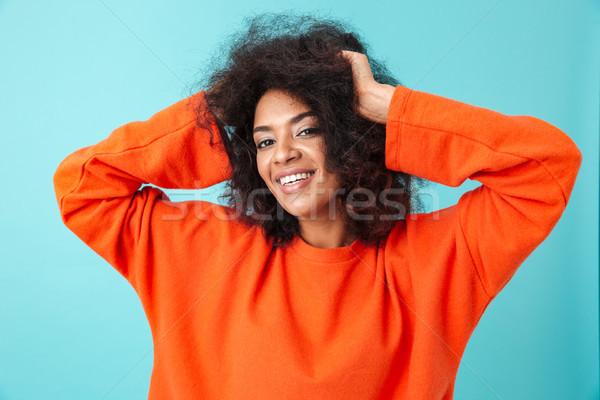 Portret zadowolony kobieta czerwony shirt stwarzające Zdjęcia stock © deandrobot